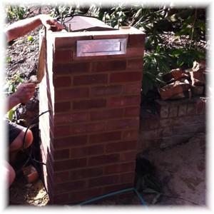Stamford mailbox built into a brick pier